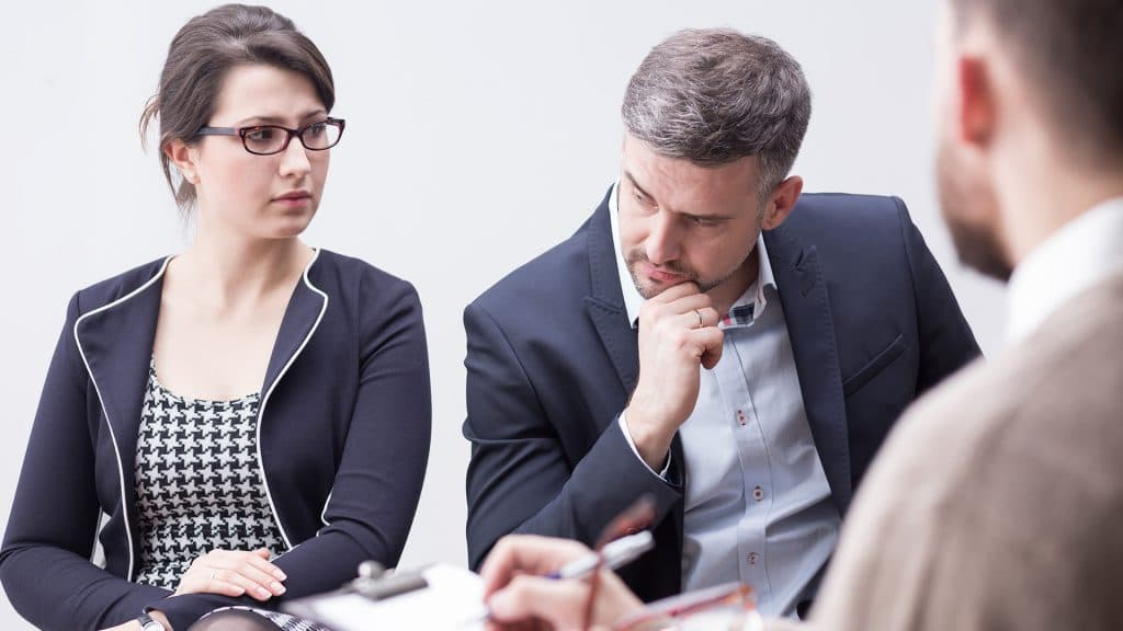 Couple meeting with therapist